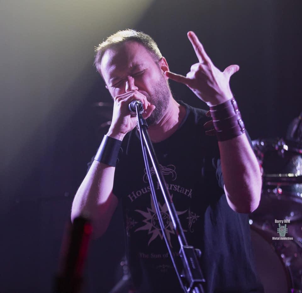 Jarlaath from Penumbra singing in concert